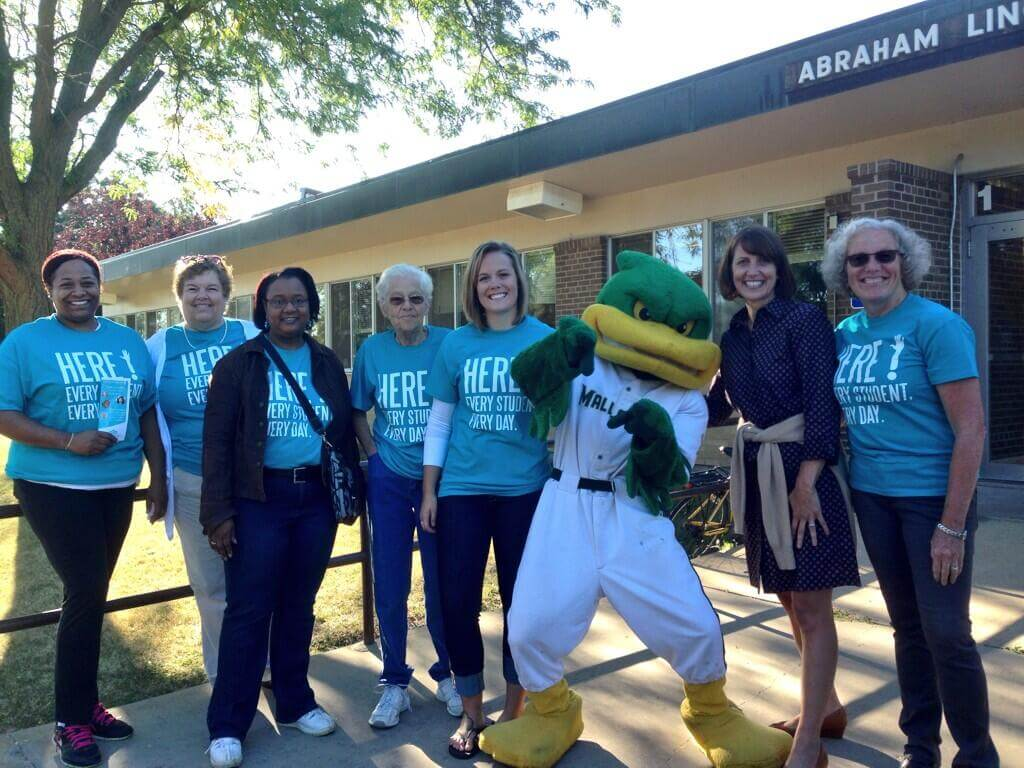 Volunteer greeters take a moment to pose with Maynard from the Mallards and Superintendent Jen Cheatham and United Way President & CEO Leslie Ann Howard